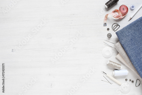Fototapety, obrazy: Fabric and sewing tools on the white wooden table