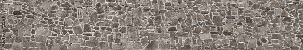 Fototapeta Texture of a stone wall. Old castle stone wall texture background. Stone wall as a background or texture.