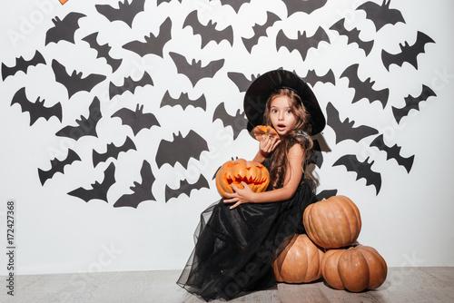 Fototapeta Excited cheerful little girl dressed in halloween costume obraz
