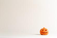 Halloween Pumpkin Ornament On An Off White Background