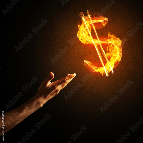 Canvas Prints Flame Concept of money making with dollar currency fire symbol on dark background