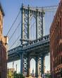 Empire State building through the Manhattan Bridge, Washington St, Dumbo, Brooklyn, New York, USA