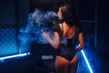 Young Sexy Woman Is Vaping E-c...