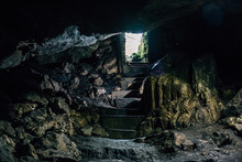 Dark Cave With Steps Of Stairc...