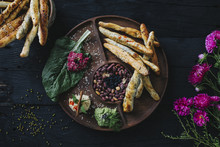 Bread Sticks Served On Tapas Wooden Plate