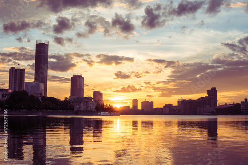 Foto op Aluminium New York Yekaterinburg city center on sunset. City pond view, amazing clouds and sky. High buildings, skyscrapers on the embankment of the river Iset