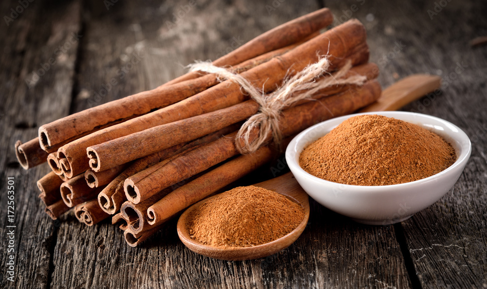 Cinnamon powder on table wooden