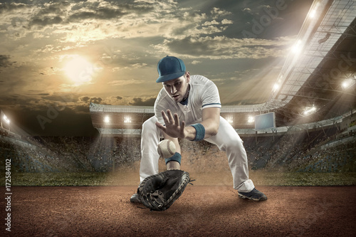Baseball players in action on the stadium. Poster