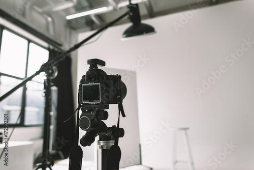 Fototapeta digital camera in photo studio obraz na płótnie