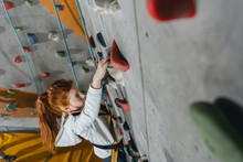 Little Girl Climbing Wall With...