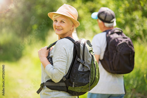 Fotografie, Obraz  Senior couple hiking