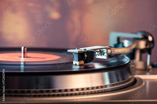 Fotografie, Obraz  Vinyl record player, bright lights disco-bokeh