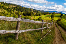 Old Wooden Fence Near The Mountain Road In The Carpathians