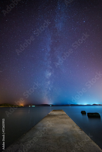 Night scene with stone pier and starry sky