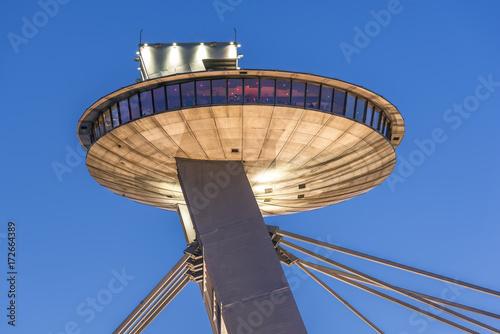 Foto op Canvas UFO Tower of SNP Bridge (Bratislava, Slovakia) on summer sunset