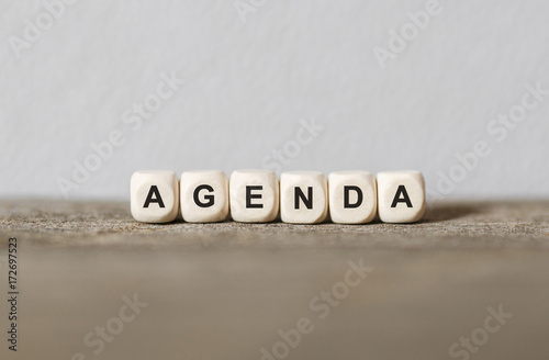 Photo Word AGENDA made with wood building blocks