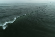 Scenic View Of Waves On Sea Ag...