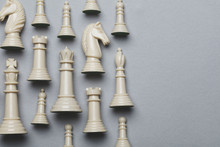 Chess Game Pieces On A Grey Ba...