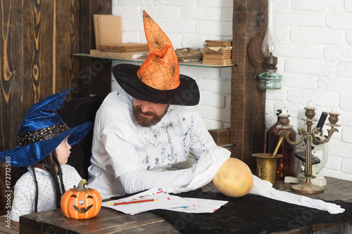 Photo Witcher and little magician make decor for Halloween
