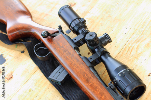 Foto op Canvas Jacht close up of rifle telescope for sport hunting on table wooden
