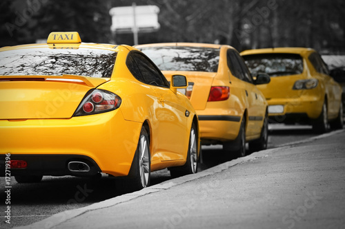 Deurstickers Oude auto s Closeup of yellow taxi cab in traffic jam