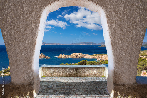 View from an archway leading to a Mediterranean cost Wallpaper Mural