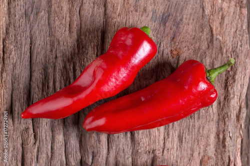 Staande foto Hot chili peppers Red chilly pepper on wooden black background. Red hot chili peppers.
