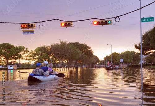 Fototapeta HOUSTON, USA - SEPTEMBER 2, 2017: Working traffic lights over flooded Houston st
