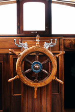 Wooden Helm On A Boat