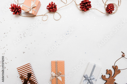d599a66d194e Festive background of Christmas holiday. Gift boxes on white background  with silver star tinsels and
