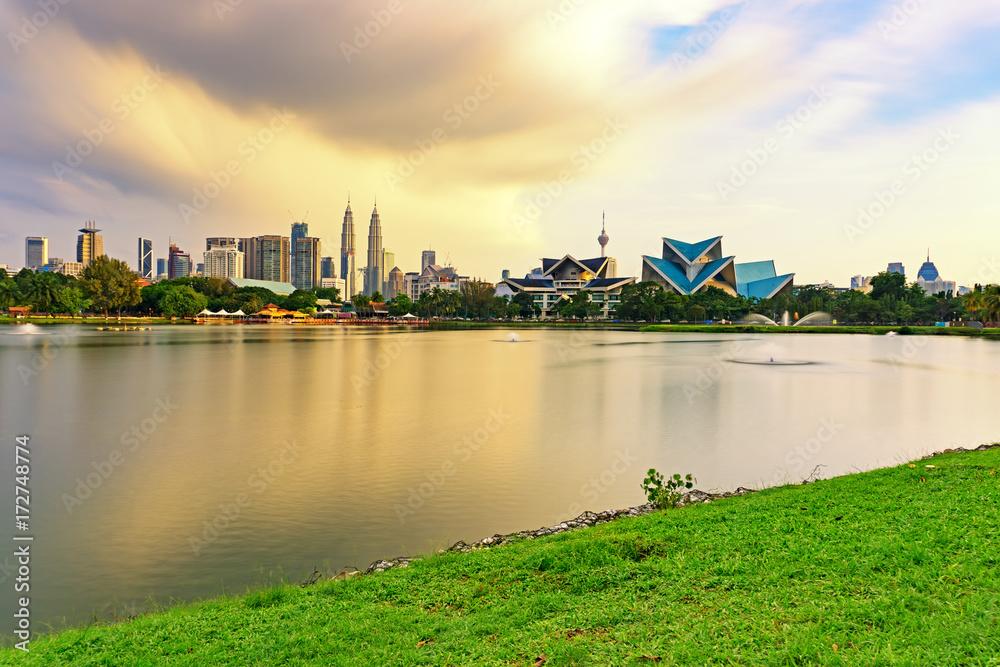 Plagát  Dramatic storm sunset over Kuala Lumpur skyline, capital city of Malaysia as seen from Taman Tasik Titiwangsa