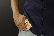 Man Putting Brazilian Money In...