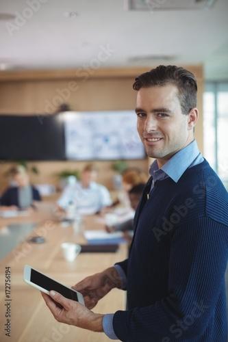 Fototapeta Portrait of smiling businessman using digital tablet obraz na płótnie