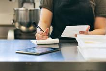 Bakery: Baker Writing Down Needed Ingredients