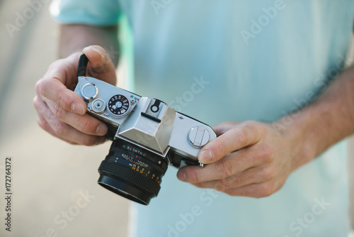 Photographer holding an analog camera