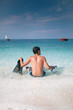 Young man looking at the sea,