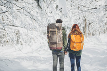 Couple With A Backpack Hiking