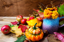 Rustic Thanksgiving Table Centerpiece With Tagetes Flowers