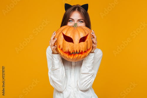 Fotografie, Obraz  Happy young woman dressed in crazy cat halloween costume