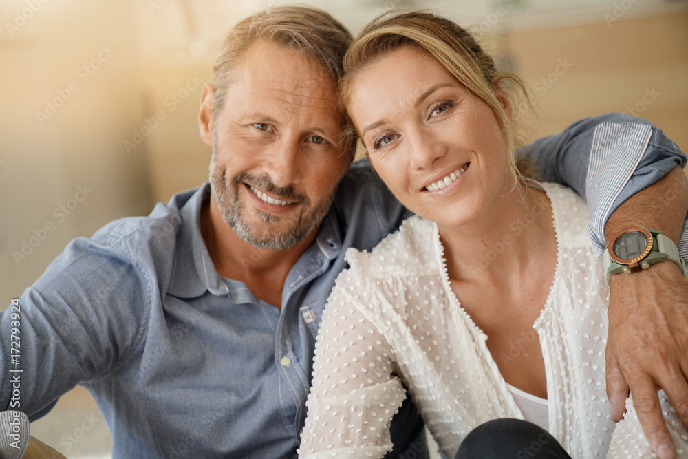 Fototapety, obrazy: Mature couple relaxing at home, looking at camera