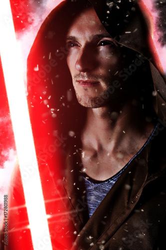 Photo  dark warrior holding a red light saber