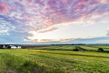 Dramatic summer sunset over a humble farm in the black dirt region of Pine Island, New York