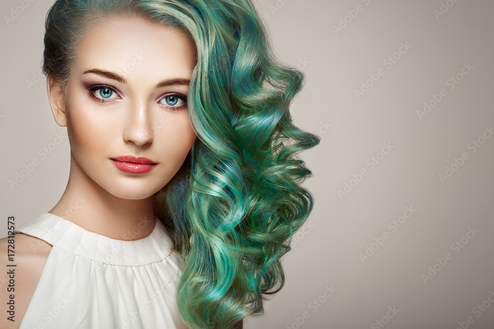Fototapeta Beauty fashion model girl with colorful dyed hair. Girl with perfect makeup and hairstyle. Model with perfect healthy dyed hair