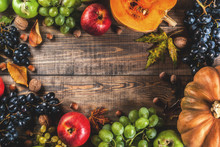 Autumn And Thanksgiving Harvest Concept. Seasonal Fall Fruits And Pumpkin On Wooden Table, Copy Space