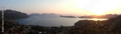 Poster Chocolate brown Panoramic dusk view from above with sea and mountains