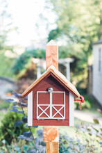 Mailbox Or Postbox Shaped Like A Little Red Barn.