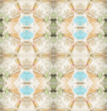 Peach And Pale Blue Jewel Like Pattern Inside Ancient Kaleidoscope