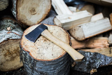 Hatchet On A Woodpile