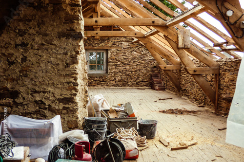 Foto op Plexiglas Fiets Old typical stone wall house undergoing a roof renovation - French countryside
