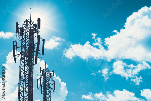 Photo communication tower or 3G 4G network telephone cellsite silhouette on blue sky a